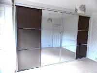 brown and mirrored sliding wardrobe doors