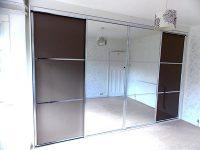 brown and mirrored sliding wardrobe doors