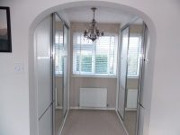 white double sliding mirrored sliding wardrobe doors