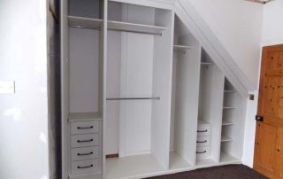 inside a beautiful white and mirrored door, custom fitted wardrobe in a loft conversion
