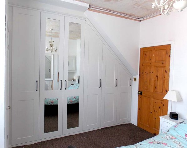 beautiful white and mirrored door, custom fitted wardrobe in a loft conversion
