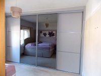 white and mirrored sliding wardrobe doors