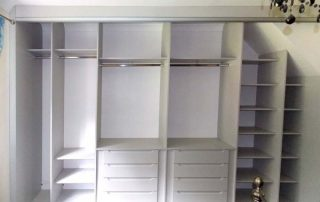wardrobe interior fitted into a reduced height sloping loft conversion