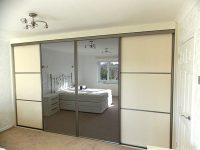 elegant white panel, grey frame and mirrored sliding wardrobe doors