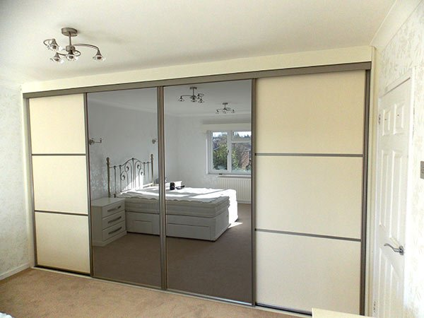elegant white panel, grey frame and mirrored sliding wardrobe doors