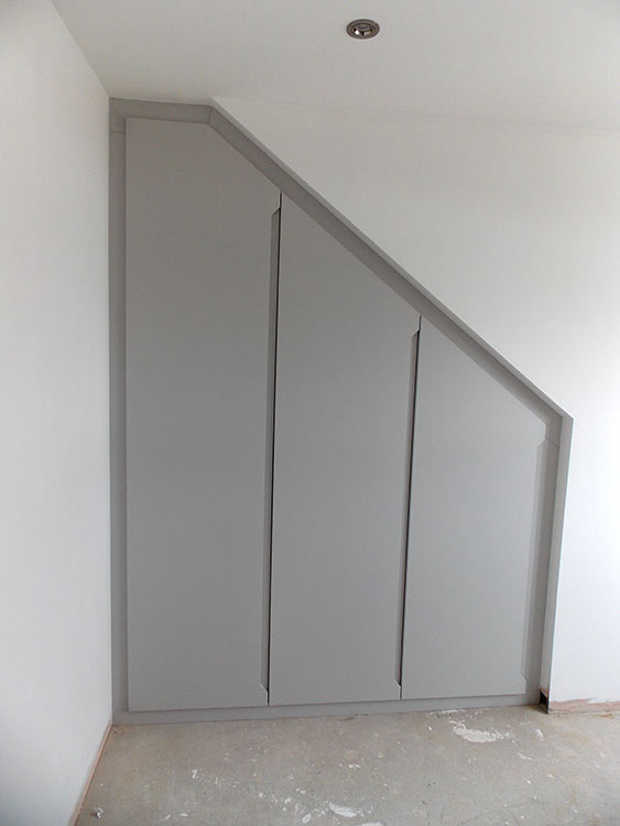 finished grey loft conversion wardrobe-with-modern grey handleless doors
