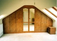 knotty pine wardrobe with hinged doors custom fitted into a sutton coldfield home