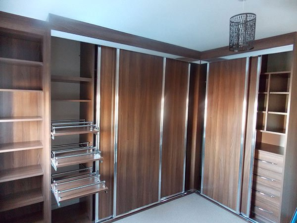 deep brown timber and chrome sliding door wardrobe