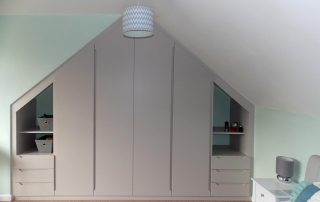 sliding door wardrobe in loft conversion