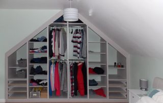 sliding door wardrobe open in loft conversion