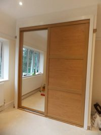 beautiful shaker style pine effect sliding door wardrobe with mirrored door