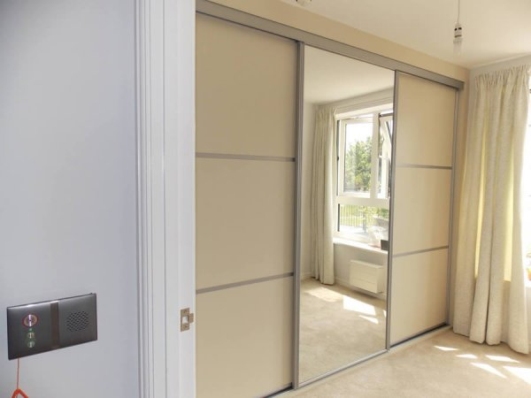 cream and grey metal mirrored sliding door wardrobe
