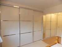 treble and double sliding door wardrobes in white and stainless steel