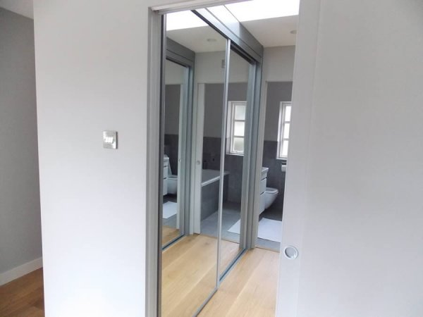 innovative mirrored sliding door wardrobe installation