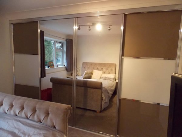 brown and white panneled doors with central mirrored sliding door wardrobe