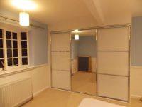 white panelled sliding door wardrobe with centra mirror door