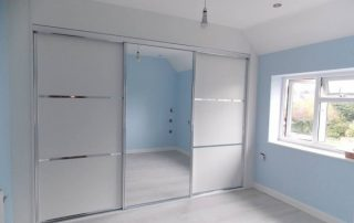 white panelled mirrored sliding wardrobe door with aluminium framework