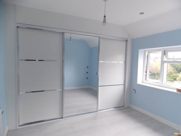 white and chrome mirrored sliding door wardrobe