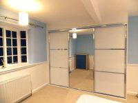 beautiful modern white panelled and mirror sliding wardrobe