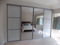 mirrored sliding wardrobe doors and white panelled wardrobe