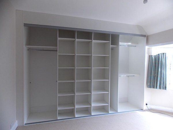 inside sliding wardrobe doors and white panelled wardrobe