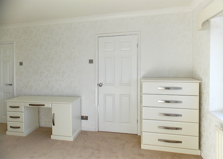 custom made chest of drawers and desk in bedroom cream