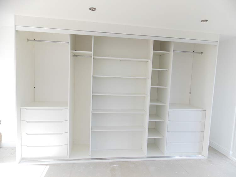 large triple wardrobe interior layout