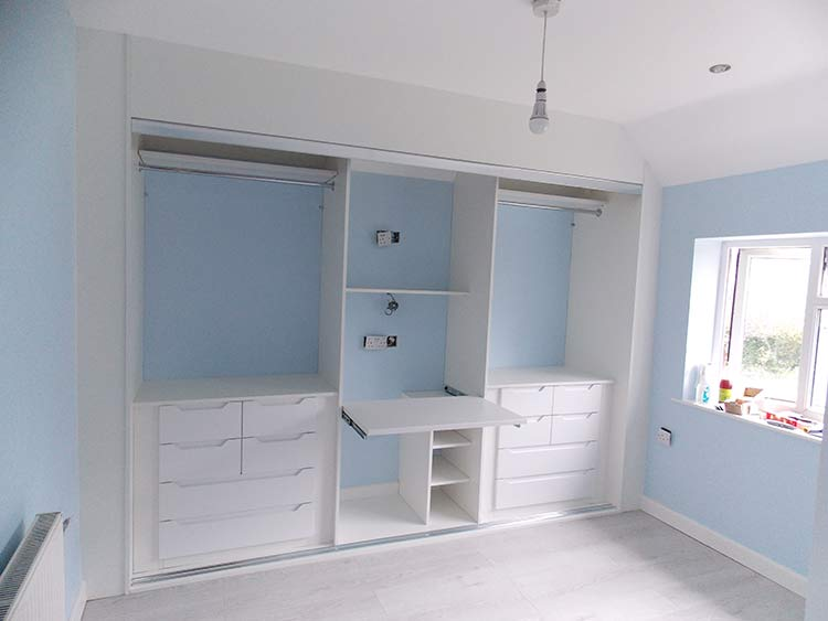 wardrobe interior configuration including foldout desk