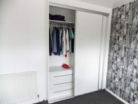 white gloss wardrobe interior configuration