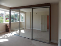 triple sliding mirrored-wardrobe-doors