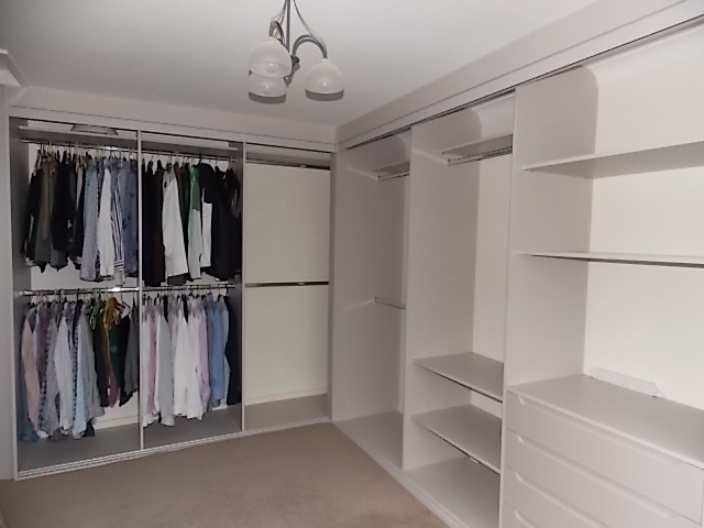 vanity room custom built-in shoe and bag storage open