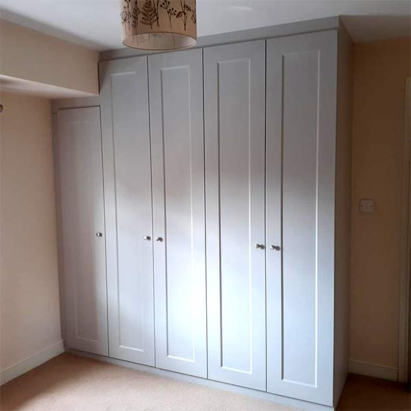 light-grey fitted hinged wardrobe front view