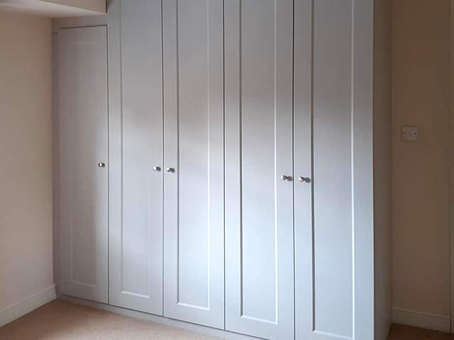 light-grey hinged wardrobe featured