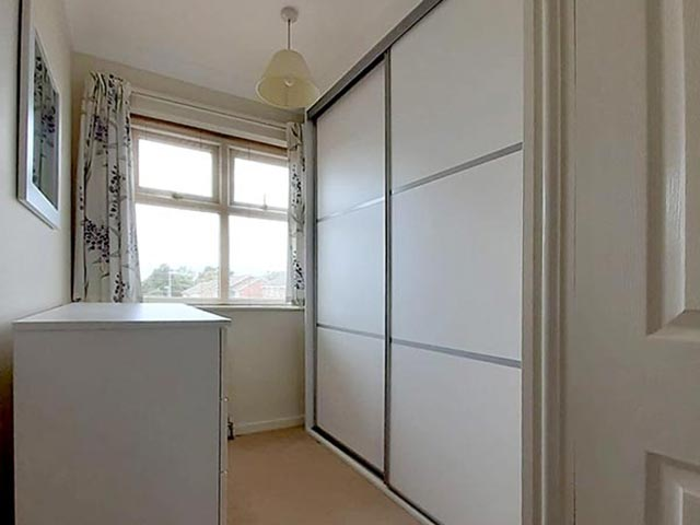 two-door sliding-wardrobe with eight-draw chest of drawers